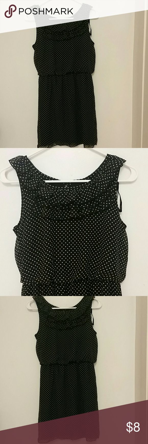 "Sweet Stirm Dress Polka dot dress with peep hole in back , button for closure 3 ruffles in front , soft and flowing with elastic waist.the material is 100% polyester , the measurements are 16"" across chest and 25"" from arm pit to hem!!!!build in slip. Really cute! Dresses Midi"
