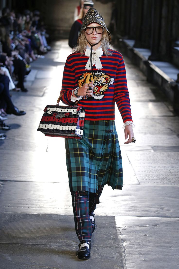 Gucci Cruise 2017, navy and red striped sweater and tartan skirt layered over tartan pants.