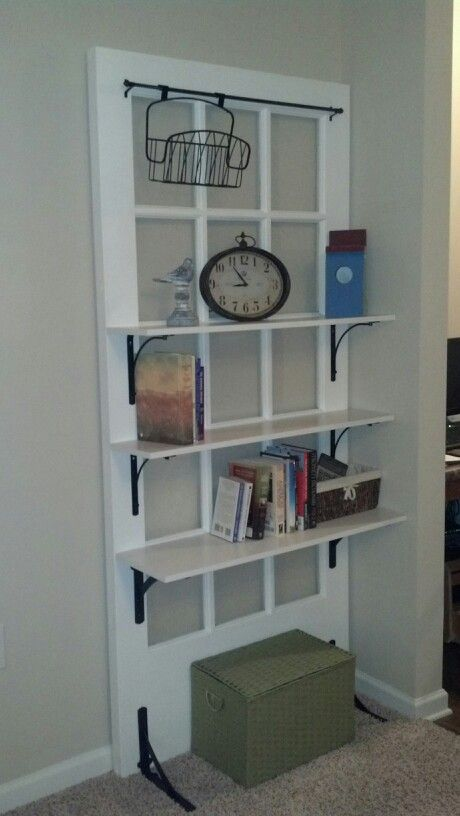 Old French door turned into shelves. It was a fun project.
