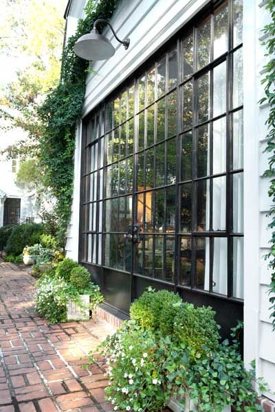 """inspiration for the back studio. LOVE the black,white & brick with classic planters.""-JanAnderson http://www.pinterest.com/rustysurfer/our-1928-home/  via hammersmithatlanta.com"