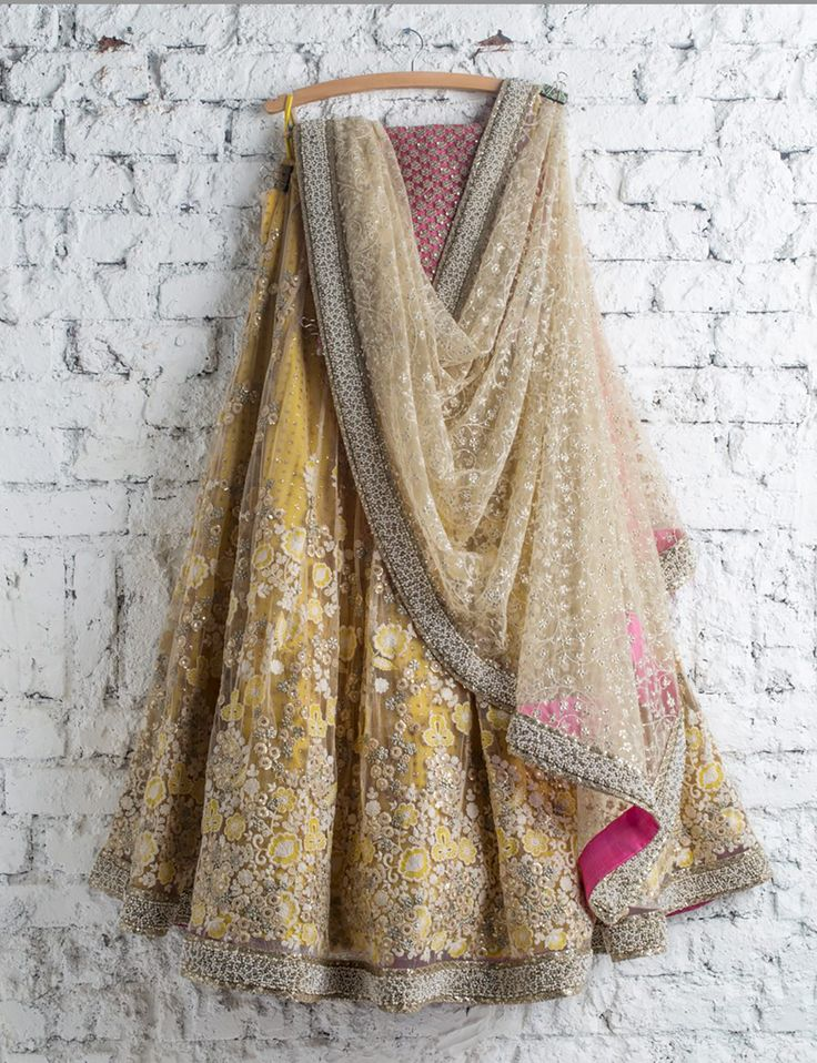 SwatiManish : Yellow lehenga with pearl white thread work and white dupatta