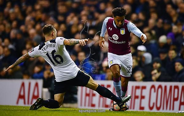 LONDON, ENGLAND - JANUARY 08: Jordan Amavi of Aston Villa (R) attempts to take the ball past Kieran Trippier of Tottenham Hotspur (L) during The Emirates FA Cup Third Round match between Tottenham Hotspur and Aston Villa at White Hart Lane on January 8