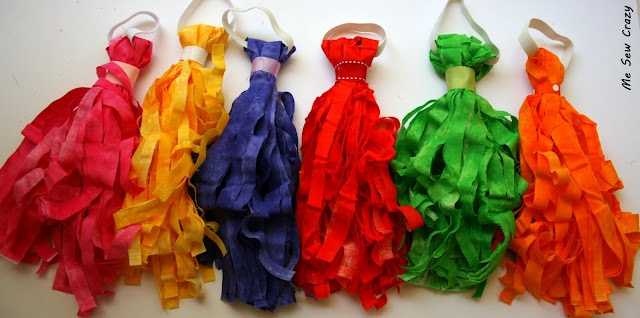 Kid's pom poms made from fabric, elastic and ribbon.