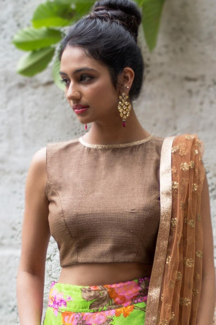 Ready to shop blouses | House Of Blouse textured brown jute brocade - Redefine sensual elegance in this earthy brown round neck blouse. The sparkle at the neckline and the back is added by placing a slim dull copper border. This simple timeless blouse may fast become your go to, multi-occasion blouse. For enquiries Whatsapp +91 81050 68601. *Shipping worldwide* #saree #blouse #sareeblouse #blousedesigns #desi #indianfashion #india #bollywood #brown