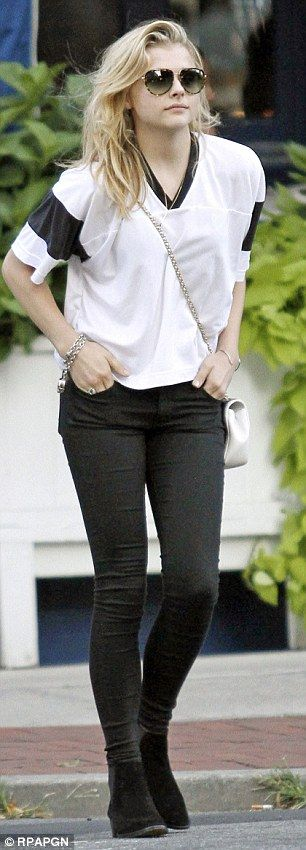Chloe Grace Moretz looked relaxed in a rugby shirt and black jeans for a casual lunch with her brother http://dailym.ai/UzGwDE
