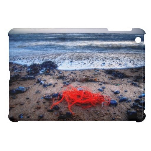 Coast Line :- Rough seas were hammering the beach at Ovingdean Gap in Brighton (England) when I decided to go for a walk with the camera. This bright red yarn that had been brought it by the tide caught my eye, it was so vibrant against the blue greys and browns. Cover for the iPadMini. #iPadMini #twine #string #line #red #cord #beach #sand #stone #pebble #tide #water #sea #ocean #wave #surf #england