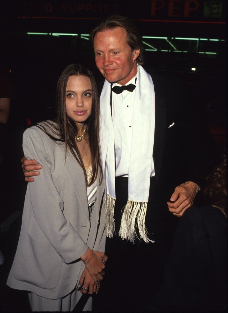 Pin for Later: See How Angelina Jolie Transformed From Hollywood Bad Girl to Blushing Bride 1991 Angelina Jolie was just a shy-looking 16-year-old when she walked the red carpet with her dad, Jon Voight.