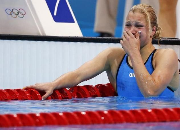 Ruta Meilutyte win Olympics 100mt Butterfly. She is 15 years old. (Reuters)