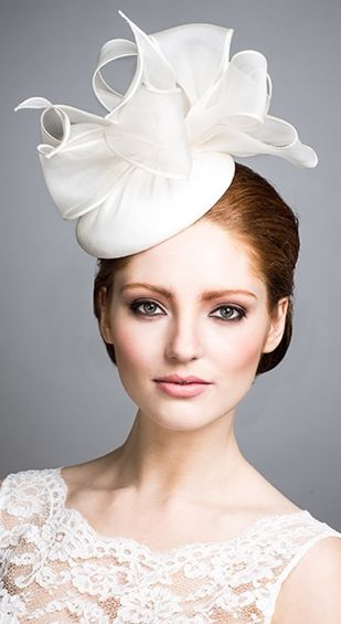 Rachel Trevor Morgan - Bridal Couture. Silk organza pillbox with organza loops.