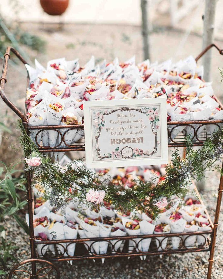 Trending Now: Wedding Ceremony Petal Bars | Martha Stewart Weddings - Here's an idea we love: Have guests grab little cones of petals from a roving cart. Whether you have an attendant pass them around during pre-ceremony cocktails or ask your (older) flower girl to push the cart along the aisle before your entrance, making it interactive is a great way to ensure everyone gets involved.