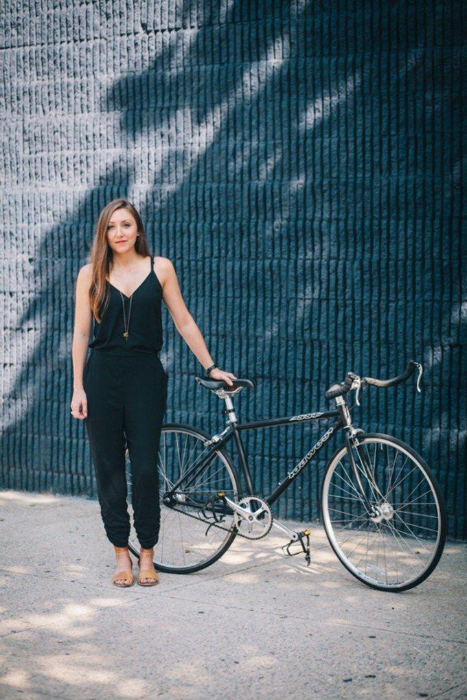 preferred mode girl on bike black jumpsuit