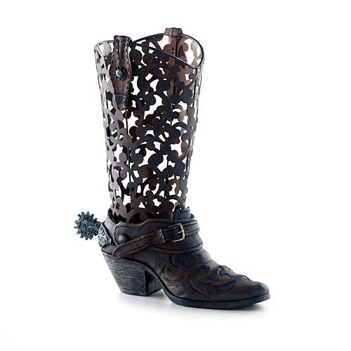 "CHEYENNE BOOT VASE  Whether your decorating style is western, rustic, or Americana, this boot vase is sure to please. The upper portion of the vase is laser cut metal with a traditional western boot design while the bottom is finished to look like well worn leather. ""Metal"" boot strap accents, spur rowel, and spur buckle add authenticity. Sitting by the hearth or a doorway accented with a fragrant candle or filled with florals and greenery, it adds a rustic touch to the room. Made of metal…"