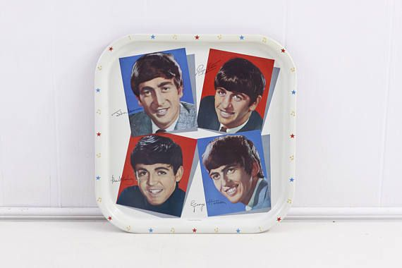 An original 1964 Beatles serving tray, Worcester ware as marked on the original label on the red back and marked to the front 6 MB Made in Britain. Features John Lennon, Ringo Starr, Paul McCartney and George Harrison.