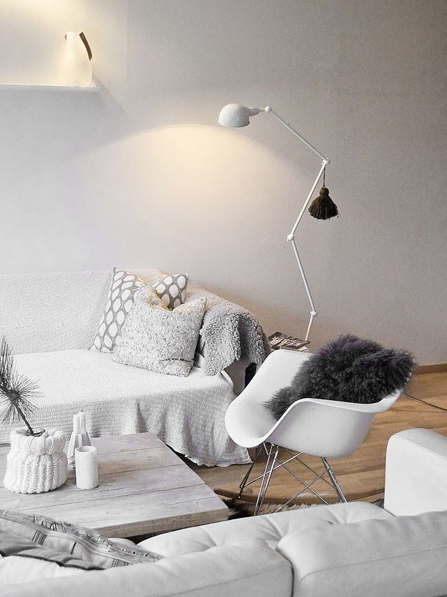 White couch minimalist living room | light gray patterned pillows