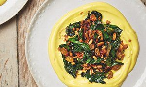 Yotam Ottolenghi's wilted spinach with saffron yoghurt and golden raisins. And spinach, potato + paneer cakes