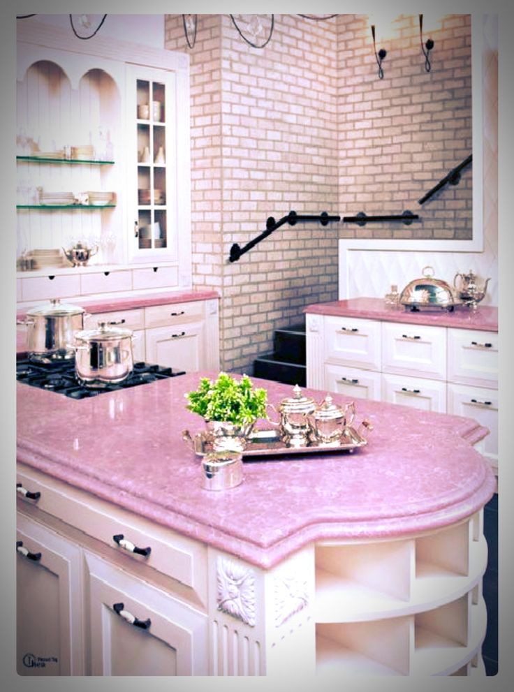 Kitchen With Pink Counter Tops Brick Wall