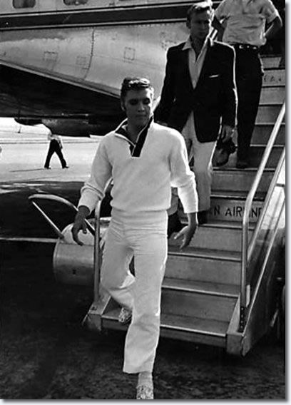Elvis de-boarding  - nobody steps off a plane like ELVIS! Notice actor, Nick Adams, just behind the king.