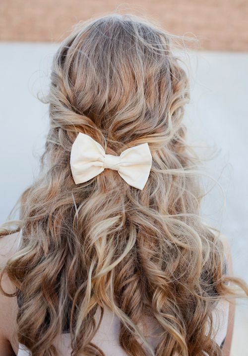 curly half up half down with bow