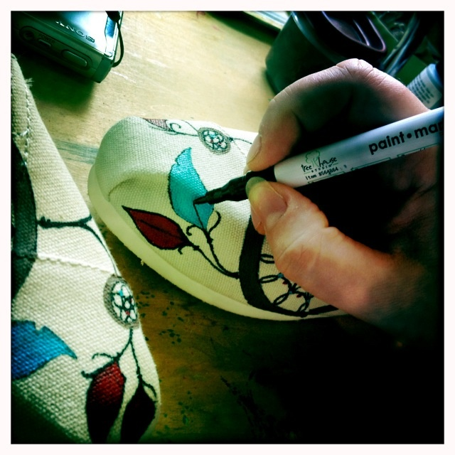 Painting on toms shoes, I can think of many other dangerous places to do this