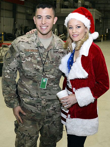 Star Tracks: Thursday, December 10, 2015 | A BIG THANK YOU | Actress Elizabeth Banks spreads a little holiday cheer on Tuesday by posing with soldiers at Bagram Airfield in Afghanistan, as part of her first-ever five-country, six-day USO holiday tour led by General Joseph Dunford, Jr., Chairman of the Joint Chiefs of Staff.