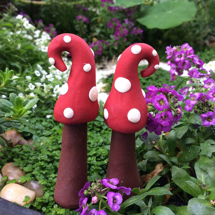 Pixi shrooms. These whimsical pair create a funky scene in a fairy garden and can be purchased from our Etsy store.