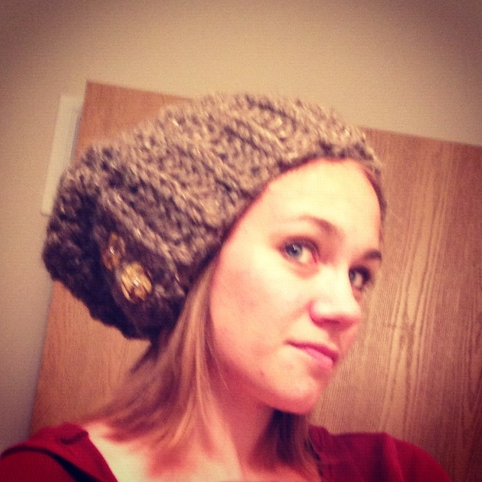 Slouchy hat with button flap.