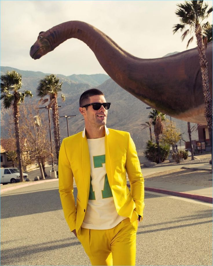 Chad White wears a yellow Paul Smith suit and graphic t-shirt with Ray-Ban sunglasses.