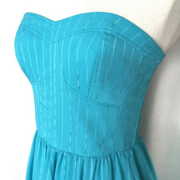"""Guess Strapless Chiffon Dress✨Host Pick✨ NWOT Beautiful turquoise/aqua strapless dress with silver metallic highlights. The top is bustier style with full skirt gathered at the waist. The sides are smocked so there is room to stretch and breath! The bodice has some boning for structure. Back invisible zipper. 99% polyester/1% metallic. Dry clean. Size 6. Bust: 15"""" flat across, unstretched. Waist: 13.5"""" across, unstretched. Length: 27"""" from center back to hem. Like New Condition. Thanks for…"""