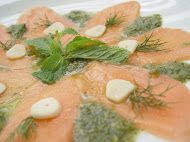 Salmon Carpaccio in Spicy Hot Sauce - Sliced fresh salmons swim in special Thai spicy sauce.