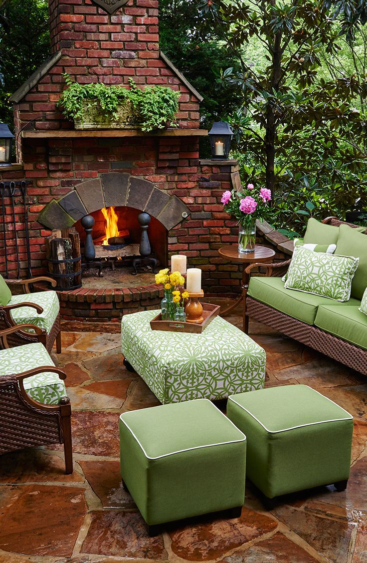 Cozy Outdoor Space... Ottomans and poufs are a great way to add a pop of color and provide extra seating.