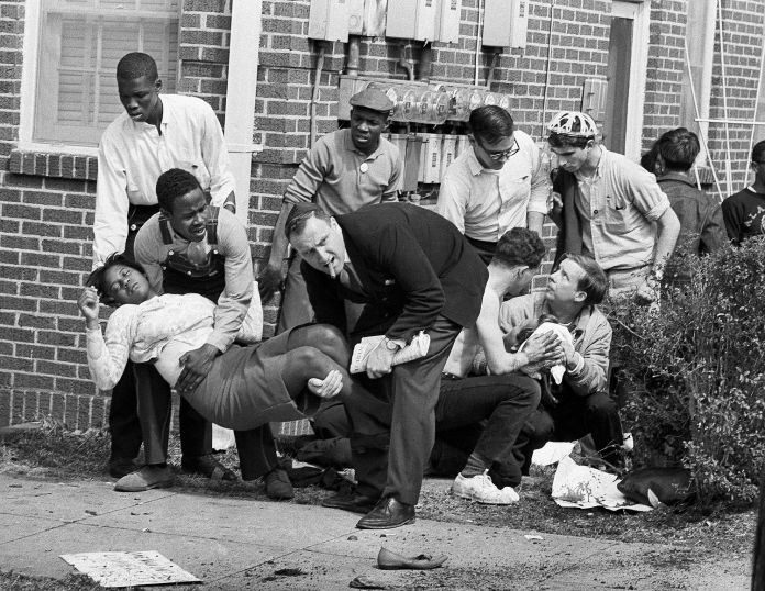 "S.W. Boynton is carried and another injured man tended to after they were injured when state police broke up a demonstration march in Selma, Ala. Boynton, wife of a real estate and insurance man, has been a leader in civil rights efforts. The day, which became known as ""Bloody Sunday,"" is widely credited for galvanizing the nation's leaders and ultimately yielded passage of the Voting Rights Act of 1965. Photo: AP / AP"