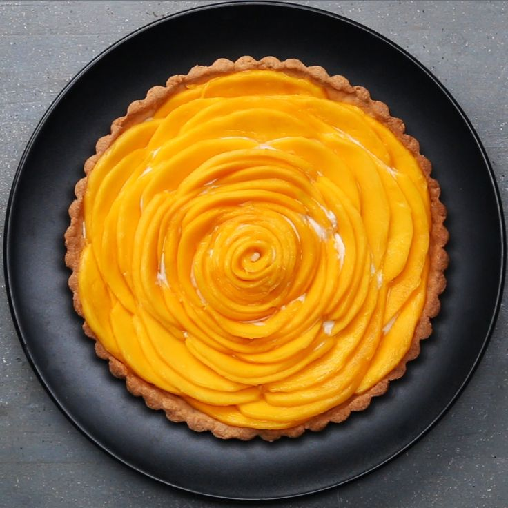 Mango Tart It's not summer here, so I don't know where I'm going to get the mangoes from but, looks YUM ‍♀️ Ps. Did you know there is no mango emoji? (I just used a lemon )