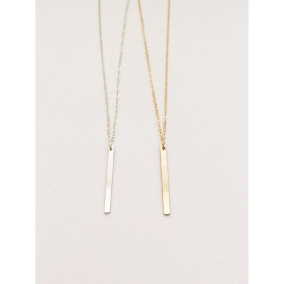 Simple Dainty Vertical bar necklace. Perfect for everyday wear, layering or gifting! •Sterling Silver - including ring and clasp •14K Gold Filled - including ring and clasp •Bar measures 2.5mm x 25mm •First Image shows 18 length •Second image shows 17 length Please note in note