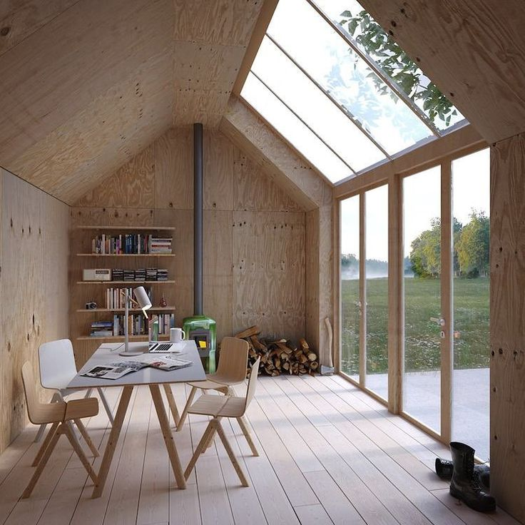 """This archetypal Swedish building form, shaped like a Monopoly house, serves as an artist's studio, with a simple plywood interior and massive skylights to…"""