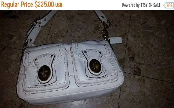 ❘❘❙❙❚❚ ON SALE ❚❚❙❙❘❘     Gorgeous Coach purse w lots of pockets (2 key turn pockets on the outside, zip pocket inside with 2 additional pockets for cell phone and business cards...vanilla...winter white color leather exterior with brass hardware and chocolate lining... in like new condition...high fashion purse   Lots of Great storage for your phone, keys, make up and change...8 ht (excluding handle length) 13 in width x  3 1/2 in depth...comfortable 10 inch shoulder drop handle.  Easily…