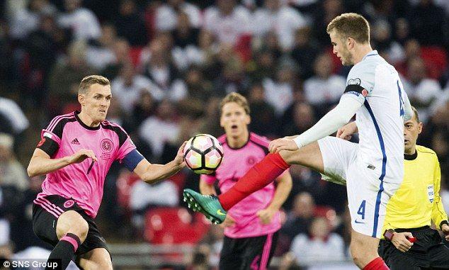 Dier gets to the ball in front of Scotland midfielder Darren Fletcher at Wembley