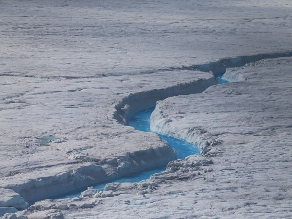 Greenland ice sheets are unexpectedly melting early.  Geothermal heat dating back millions of years ago may be playing crucial role in this. (Photo:  Joe Raedie/Getty Images)