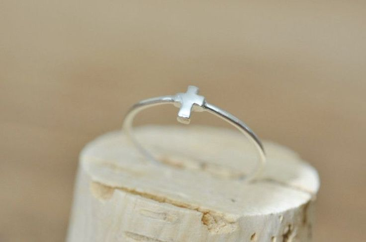 Simple Tiny Cross Ring... perfect for everyday wear * Cross measures 4mm x 5mm…