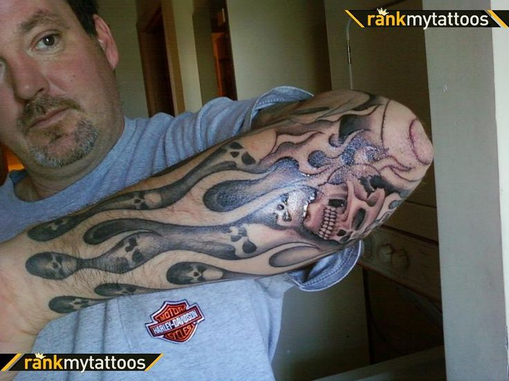 fire or flames Sleeve Tattoo Ideas | Grey Ink Skulls And Flame Sleeve Tattoo