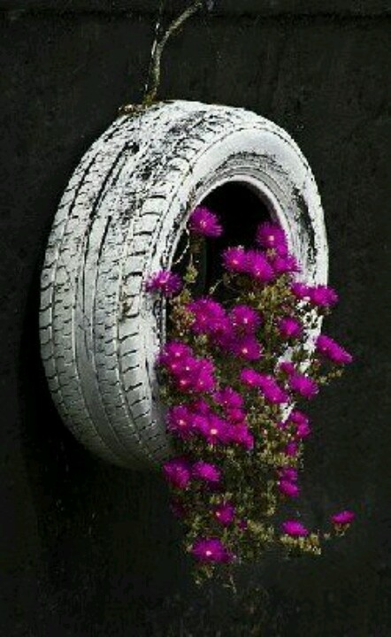 how cute would this be hanging from a tree in the backyard with flowers spilling out. Maybe paint the tire a bold color like yellow