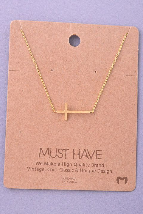 """Dainty brass cross necklace. Perfect alone or layered with other necklaces! 16"""" with a 2"""" extender."""