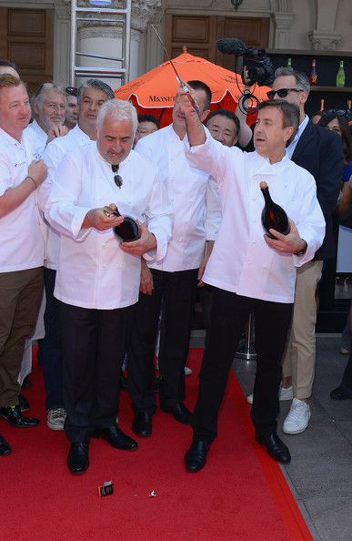 Guy Savoy Chefs Guy Savoy (L) and Daniel Boulud saber off a bottle of Mionetto Prosecco at The Venetian Las Vegas during the kick off for th...