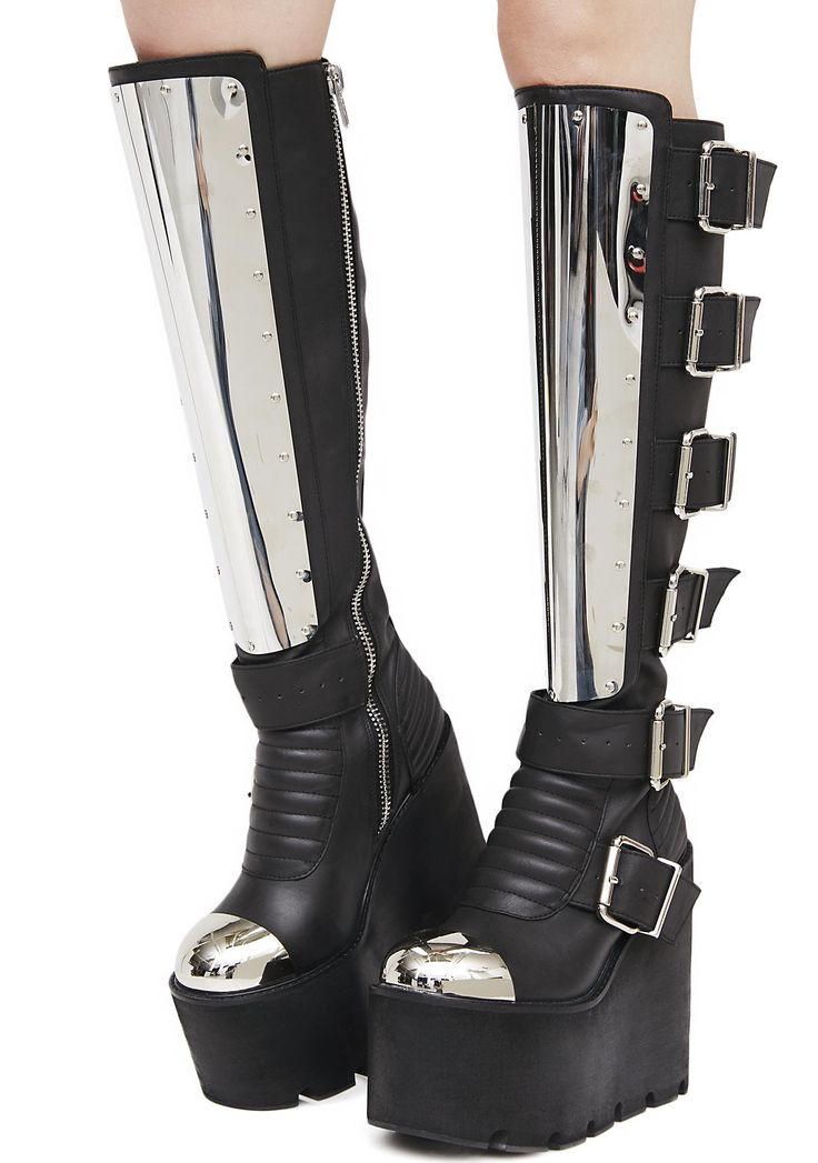 Current Mood Moto Mama Platform Boots we know yer a daughter of anarchy, babe...Tear up the streets in these sikk af boots featuring a faux-leather construction, chunky wedge platforms, adjustable buckles, metal plates on the shins N' toes and full-length zipper closure at the inner-calf.