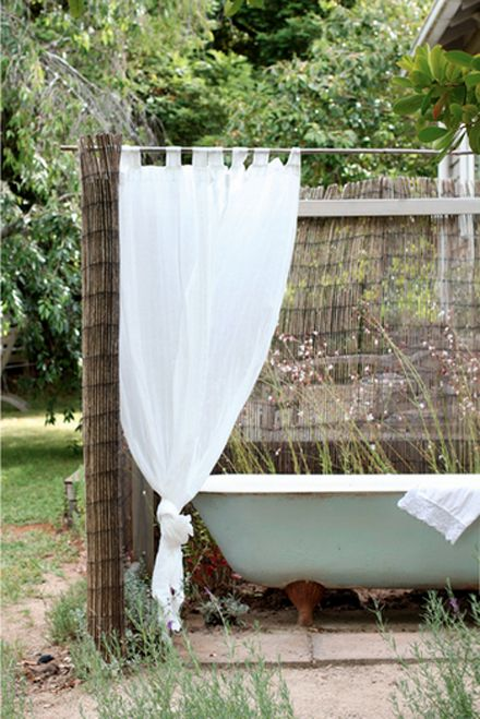 Not sure how a bath tub outside makes sense but I love this photo form the blog Down and Out Chic