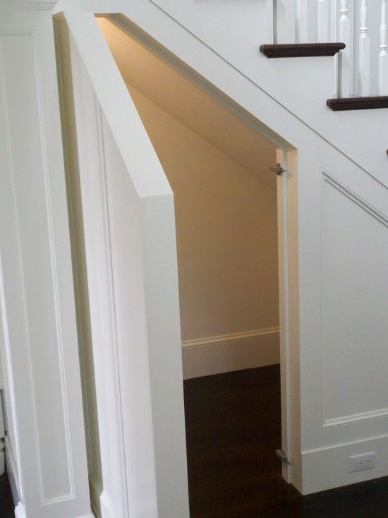 Hidden Door to storage. Toby Leary Fine Woodworking - entrances/foyers - traditional staircase, hidden nook, hidden storage nook, faux panels, faux paneling, faux s...