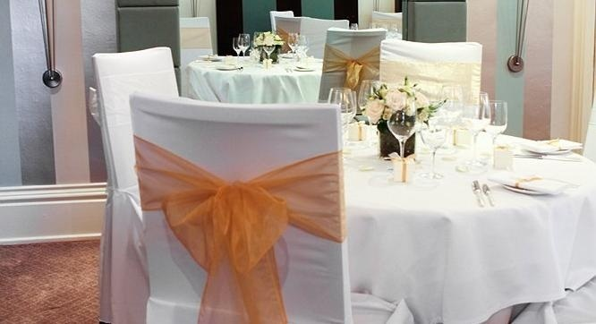 Classic wedding, gold organsa chair bow with matching napkin ribbon and favour boxes.  Photo by Ed Clayton Photography.  Products designed and styled by Fuschia.  Www.fuschiadesigns.co.uk