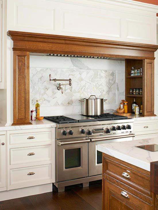 Timeless Beauty  Calacatta marble tiles installed in a herringbone pattern cover the wall behind this commercial-style range. The timeless backsplash reflects the venous marble countertops, and the soft white and gray colors provide an elegant setting for the warm wooden island and custom-built hearth.