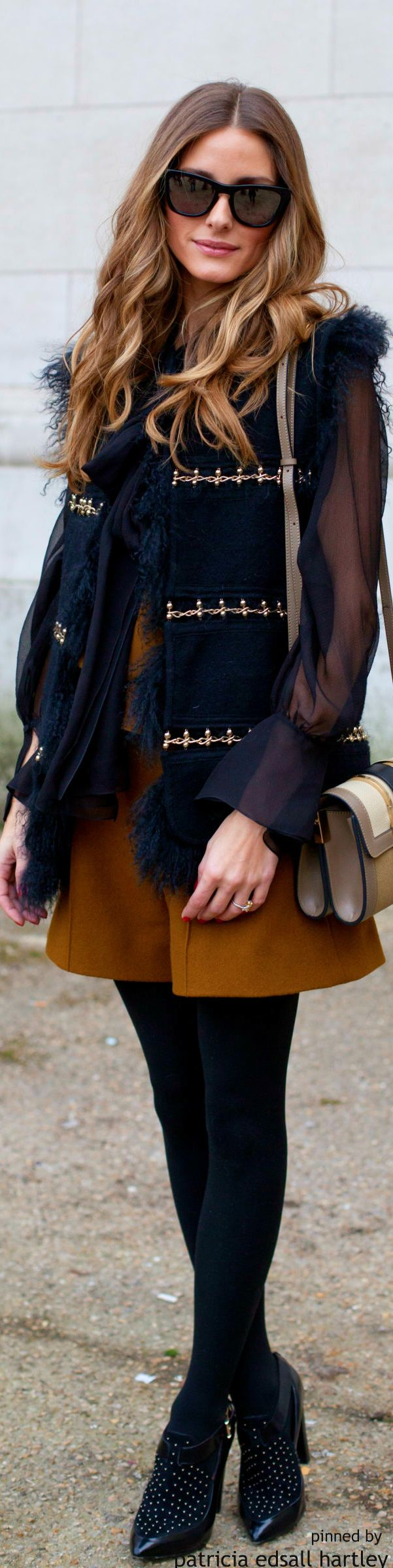 She really is a master at layering textures and fabrics to perfection. The mustard skirt breaks up the column of black for a look that is anything other than boring.