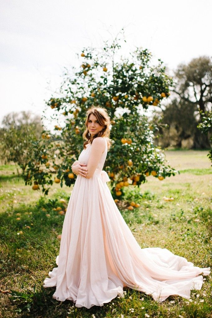 Blush pink wedding dress BHLDN Bridal at Rip Van Winkle Gardens in Louisiana. Erin and Geoffrey Photography. Bride in citrus farm. Anthropologie bridal gown