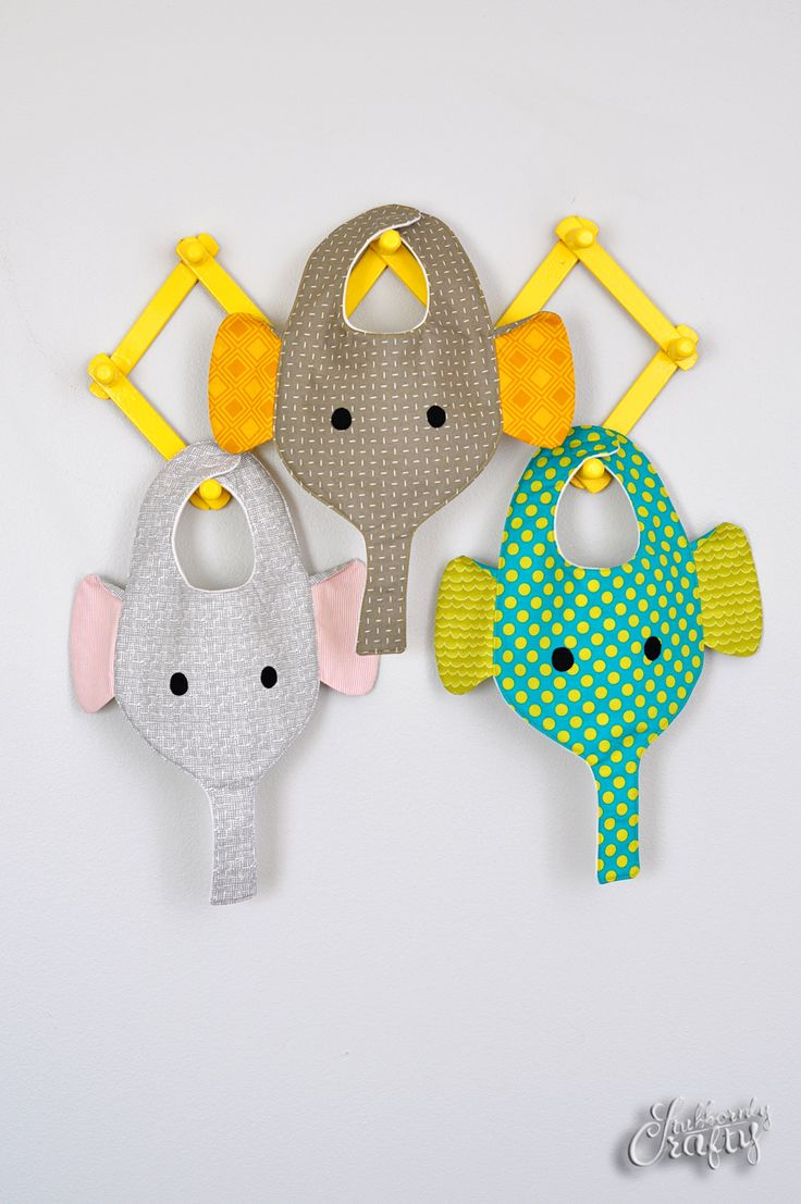 My awesome sister-in-law just had a little baby boy. She shared a photo of some combo bib binkie holders with me on Facebook. I thought they were pretty handy but not so cute, so I went to work designing a bib/binkie holder that was a bit more my style. Thus was born the elephant bib …